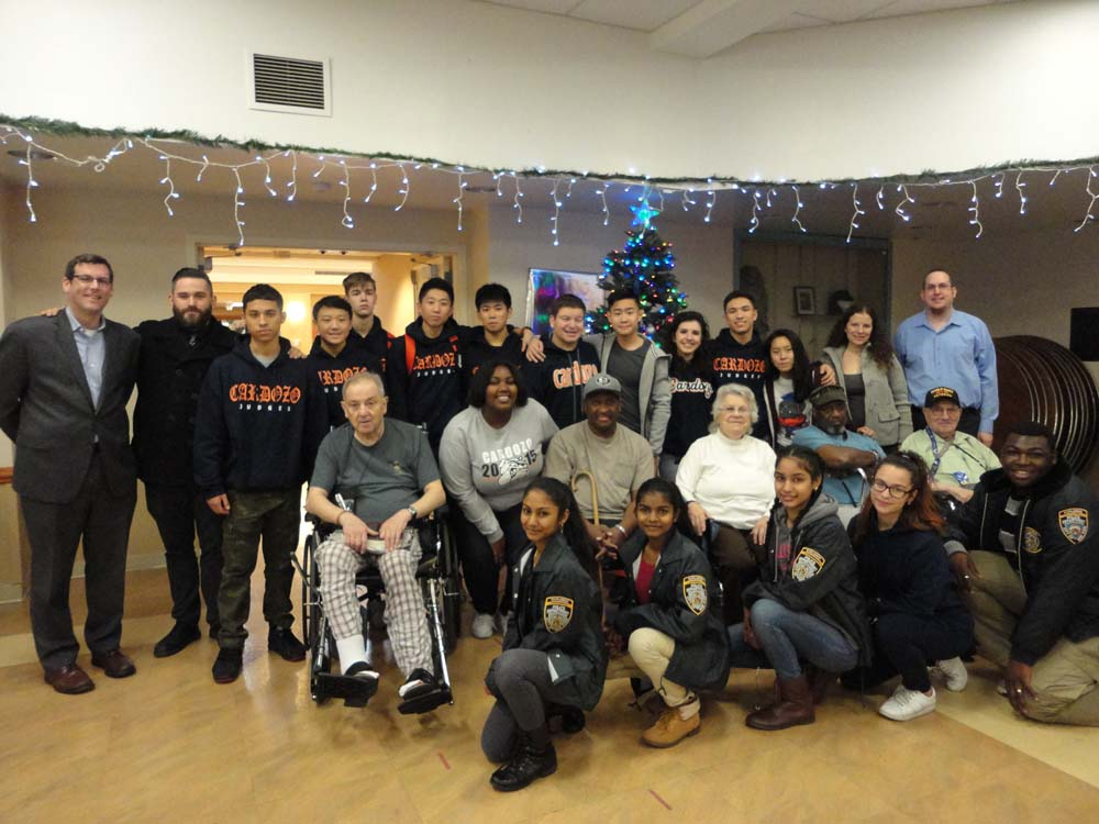 On December 18, 2015, Assemblyman Braunstein delivered gift drive donations to the NYS Veterans Home at St. Albans with students from Benjamin N. Cardozo High School. Assemblyman Braunstein is pictured with Deirdre Samuel, Coordinator of Volunteer Services at the NYS Veterans Home at St. Albans; Sgt. James Weir, Jr., a veteran of the United States Army; Pvt. Larry McKelton, a veteran of the United States Navy and the Secretary of the Residents Council at the Veterans' Home; Nina Faraguna, who served as a civilian member of the United States Navy; Cpl. Charles Hanley, a veteran of the Army; and Sgt. Vincent Macegnone, a veteran of the United States Air Force.