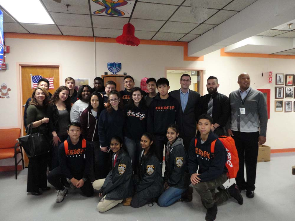 On December 18, 2014, Assemblyman Braunstein and Benjamin N. Cardozo High School students delivered donations from his annual Veterans' gift drive to the St. Albans VA Community Living Center, pictured here with VA staff.