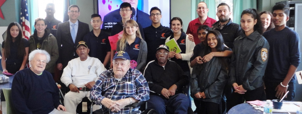 Assemblyman Edward C. Braunstein is pictured with veterans at the St. Albans Community Living Center on February 12, 2016, along with his staff and Benjamin N. Cardozo High School students and faculty.