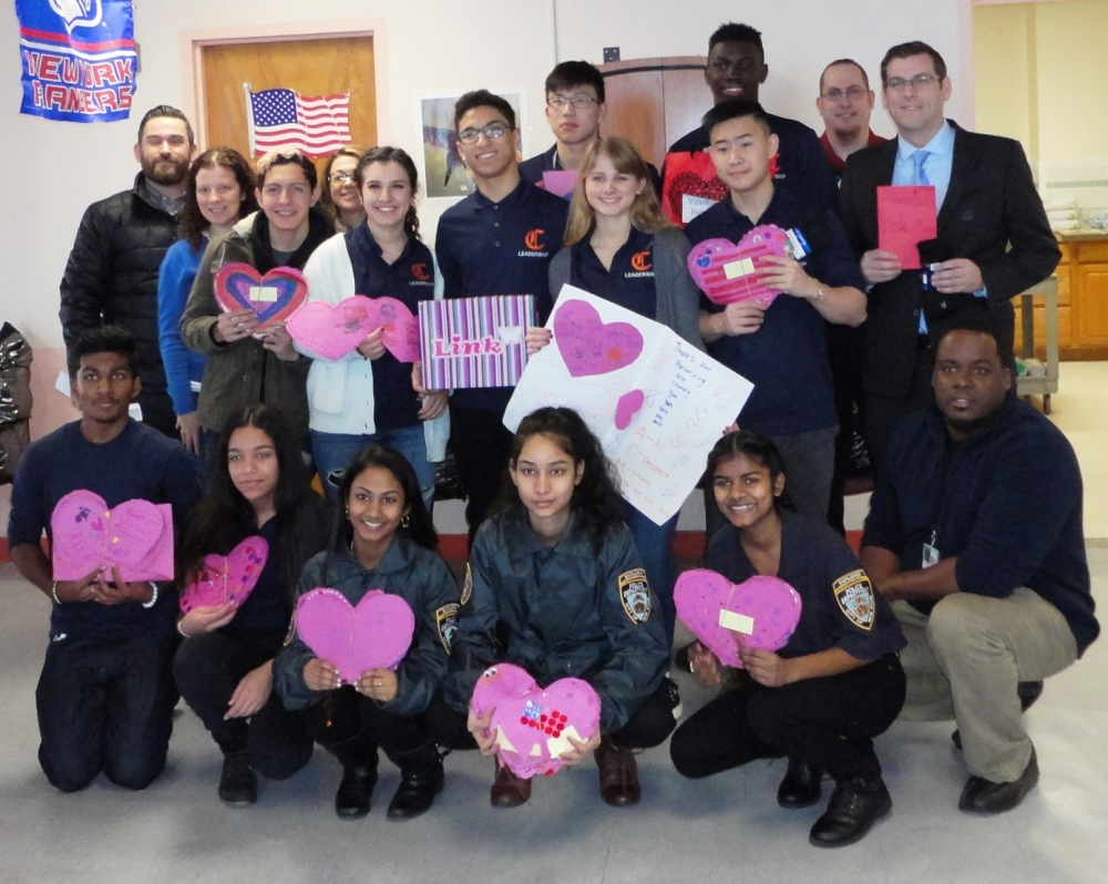 Assemblyman Edward C. Braunstein is pictured at the St. Albans Community Living Center on February 12, 2016 with donations from the 20th Annual Valentines for Vets gift drive, along with his staff, Benjamin N. Cardozo High School students and faculty, and St. Albans VA staff.