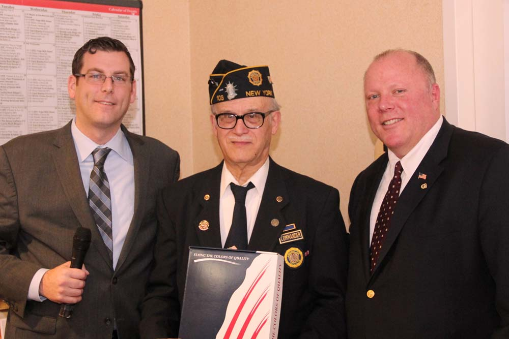 On March 6, 2016, Assemblyman Braunstein presented a New York State Flag to American Legion Little Neck-Douglaston Post 103 at the Little Neck-Douglaston Memorial Day Parade Committee Luncheon at the Brandywine Senior Living Savoy. Assemblyman Braunstein is pictured with Douglas Montgomery and Charles McBride, Co-Chairmen of the Parade Committee, and Sebastiano D'Agostino, Commander of Post 103.