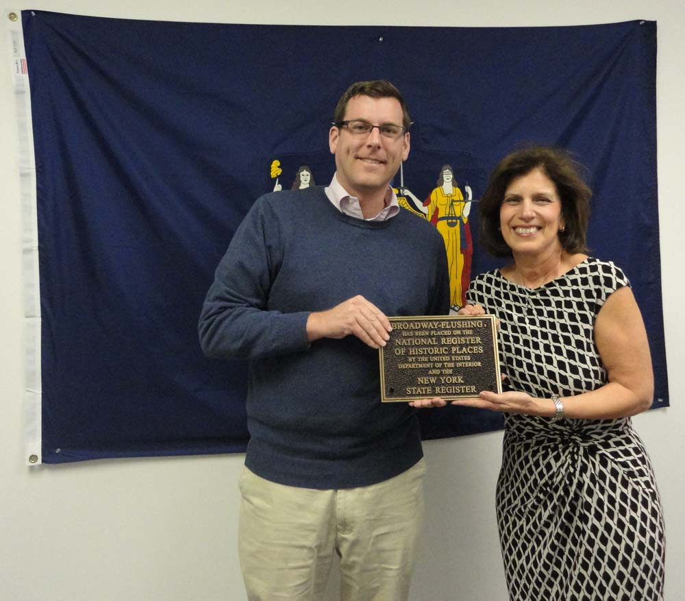 On March 18, 2016, Broadway-Flushing Homeowners' Association member Maria Becce presented a bronze plaque to Assemblyman Braunstein for him to display in his District Office. The plaque signifies the placement of Broadway-Flushing on the National Register of Historic Places by the US Department of the Interior and the New York State Register.