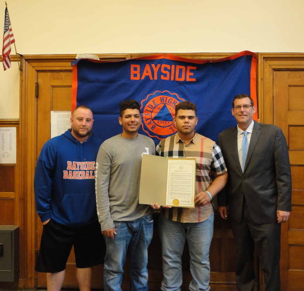 On September 19, 2016, Assemblyman Braunstein presented a New York State Legislative Resolution to Bayside High School Boys Baseball team members Daniel Alfonso and Jesse Spellman, and Assistant Coach Kevin Brown. The Bayside High School Commodores won their first PSAL AA Boys Baseball Championship in June, 2016 at Yankee Stadium.<br />