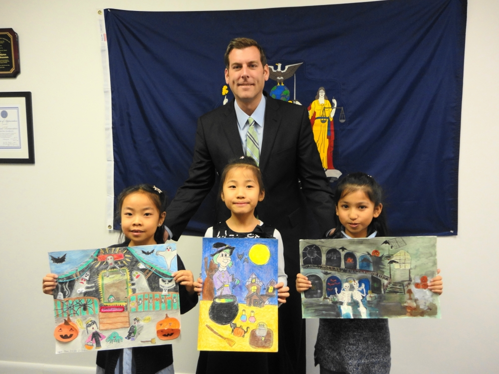 On November 21, 2016, Assemblyman Braunstein met with the winners of his Halloween Essay & Drawing Contest. Assemblyman Braunstein is pictured with Amber Zhou of PS 203, 2nd Grade Grand Prize Winner; Amy Zhou of Peihong Art Studio, 3rd Grade Grand Prize Winner; and Nora Gupta of PS 115, 4th Grade Grand Prize Winner.