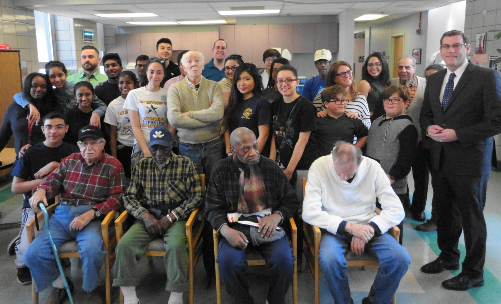 Assemblyman Braunstein is pictured with veterans at the St. Albans Community Living Center delivering donations from the 21st Annual Valentines for Vets Gift Drive, along with his staff, and Benjamin N. Cardozo High School students and faculty.<br />