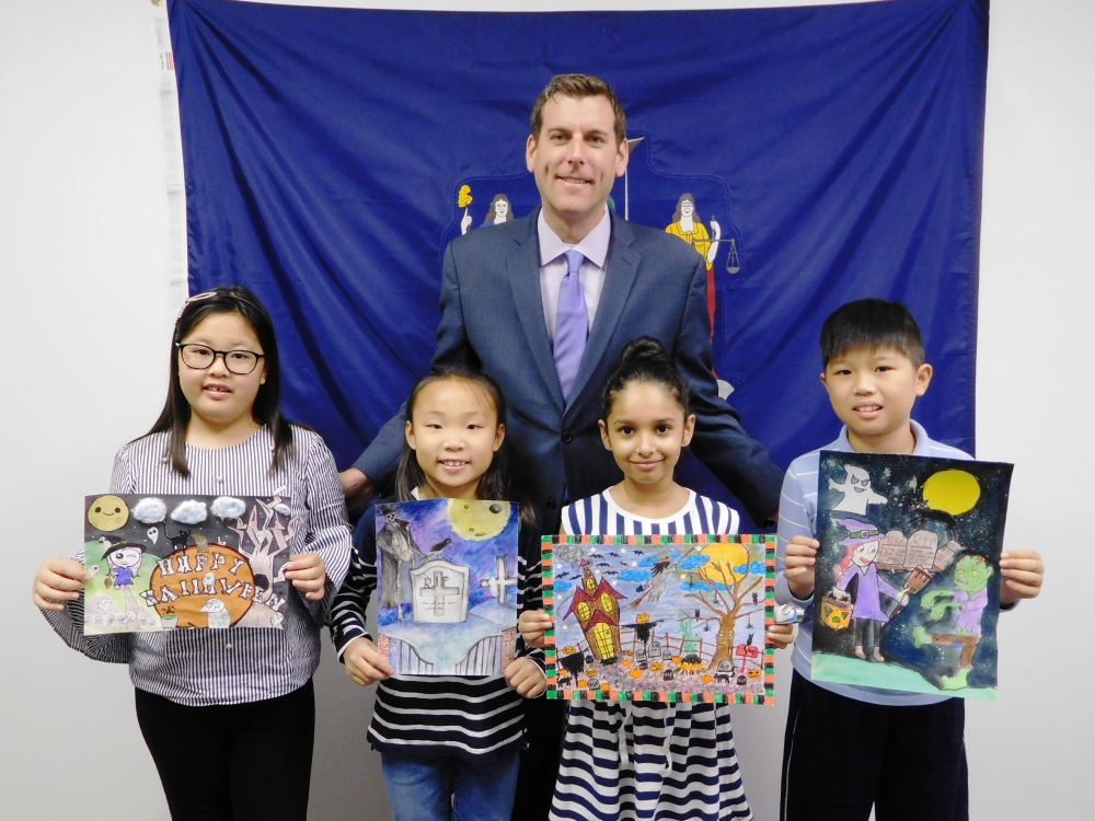 On November 20, 2017, Assemblyman Braunstein met with the winners of his office's annual Halloween Essay & Drawing Contest. Assemblyman Braunstein is pictured left to right with 4th Grade Gra