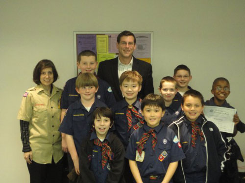Assemblyman Braunstein with Sacred Heart 4th Grade Cub Scout Pack 49 and Den Leader Gina Bacile on April 15, 2011. Assemblyman Braunstein discussed how a bill becomes a law in the State Assembly, which helped the scouts earn their Citizen pins and Webelos badge.