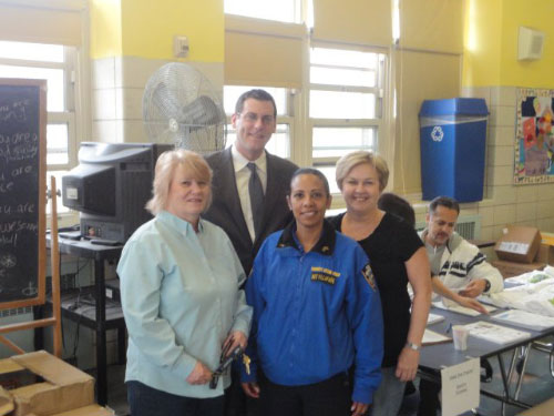 Assemblyman Braunstein with Parent Coordinator Marguerite Schlaffer, Sgt. Lizbeth Villafane & Principal Debra Buszko. On April 30, 2011, Assemblyman Braunstein joined PS 21 and the NYPD New Immigrant Unit at their 4th Annual Keeping Families Healthy & Safe Event.