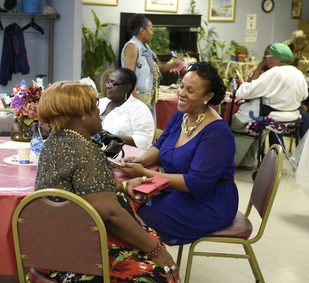 Assemblywoman Hyndman catching up with seniors at local center.<br />