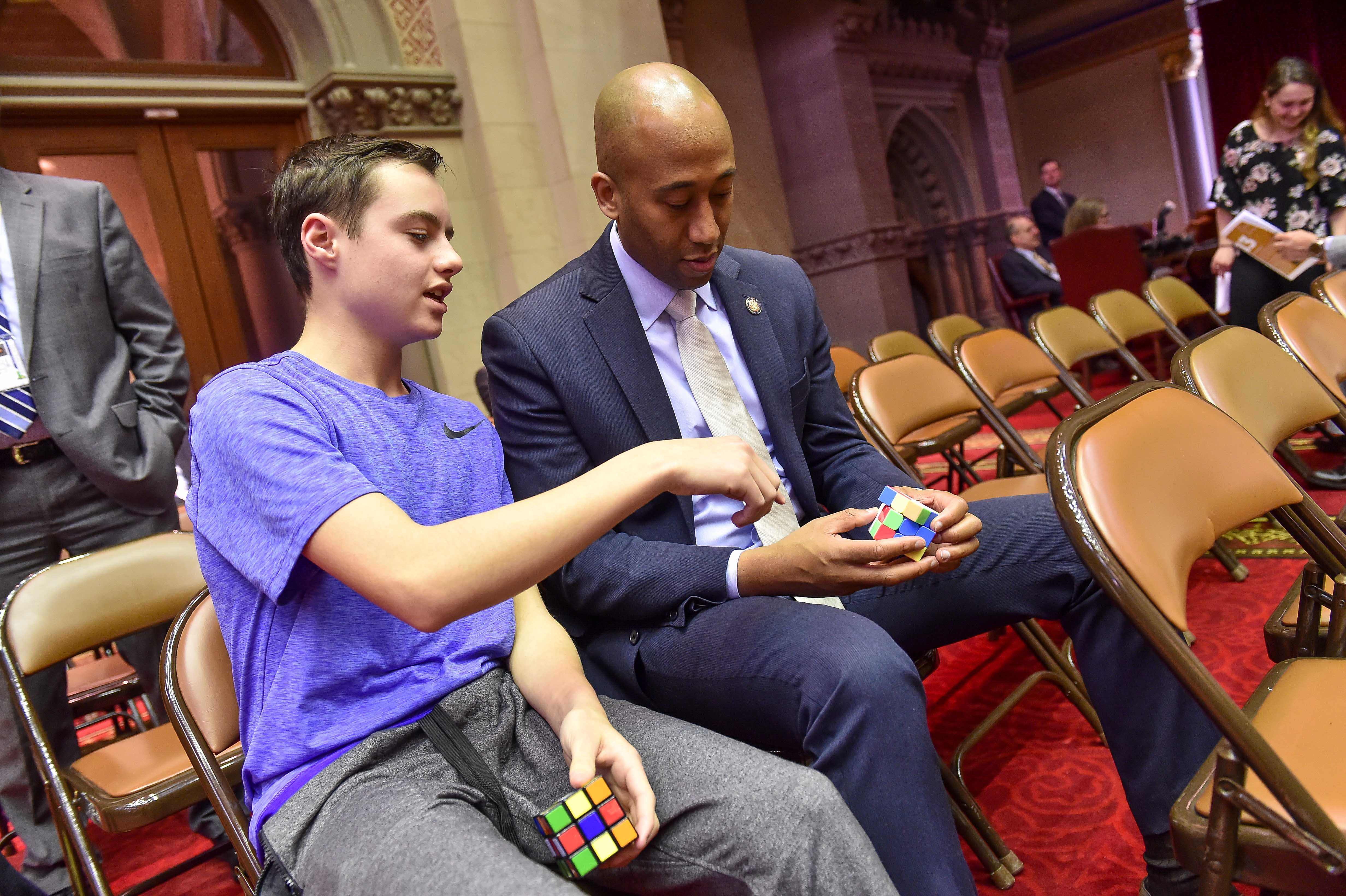 Assembly member Vanel bonding over Rubik's cubes