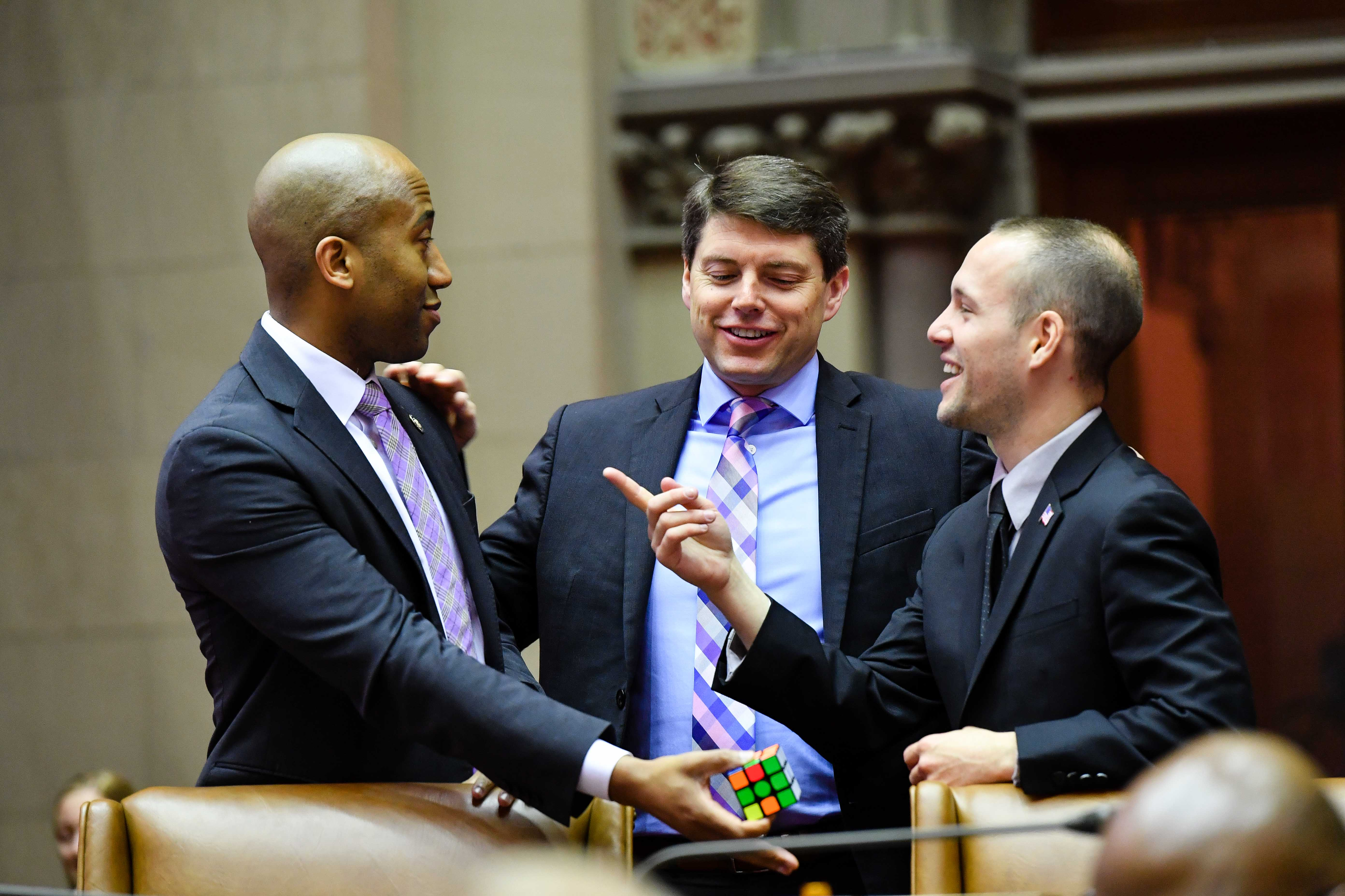 Assembly member Vanel bonding over Rubik's cubes with Assembly colleagues.