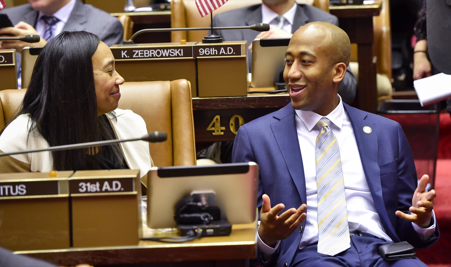 Assembly member Vanel Speaking with Assemblywomen Michele Titus.