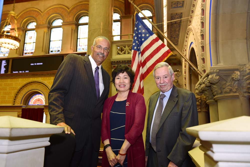 Assemblyman Aubry in chamber with Consulate General of the People's Republic of China, Zhang Qiyue and Assemblyman Peter J. Abbate