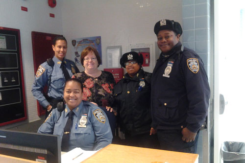 Assemblywoman Catherine Nolan with several school safety guards at the newly constructed Maspeth High School in Queens
