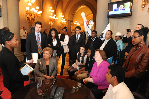 Assemblywoman Catherine Nolan speaking with students from the East Ramapo central school district