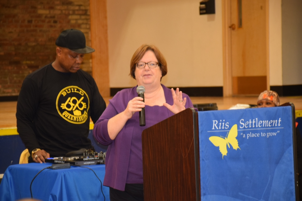 Assemblywoman Catherine Nolan speaking at the event at Jacob Riis Settlement House.