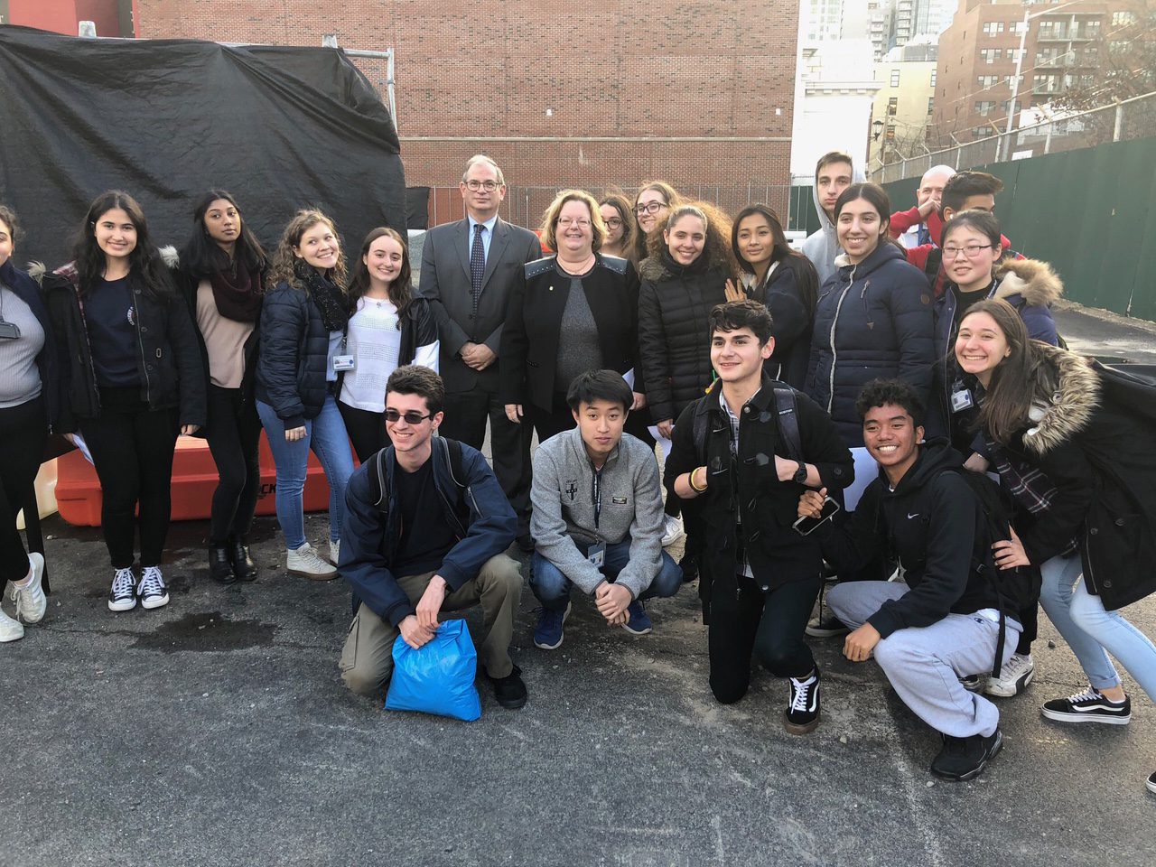 Assemblywoman Catherine Nolan, Principal William Bassell and several students from the school.