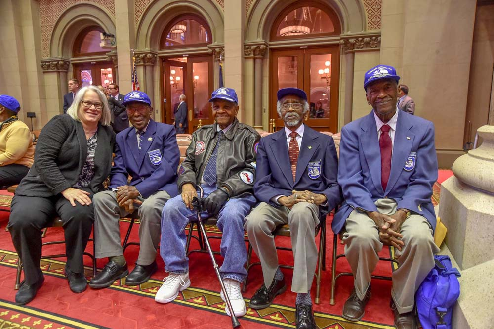 Assemblywoman Weinstein posed with the Tuskegee Airmen, the all-black Air Force squadrons, who served with distinction during World War II and helped lay the groundwork for the Civil Rights Movement of the 1960s.