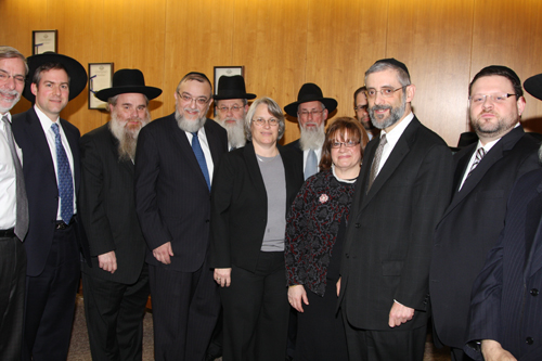 Assemblywoman Helene Weinstein and colleague Assemblyman Dov Hikind meet with a delegation from Agudath Israel of America during a visit to Albany. The delgation was in the Capitol to restore crucial Comprehensive Attendance Program (CAP) funding that was cut from the executive budget for mandated programs in private schools. The Assembly was successful in restoring the funds and reinstated the policy of reimbursing these schools for prior compliance with the program.