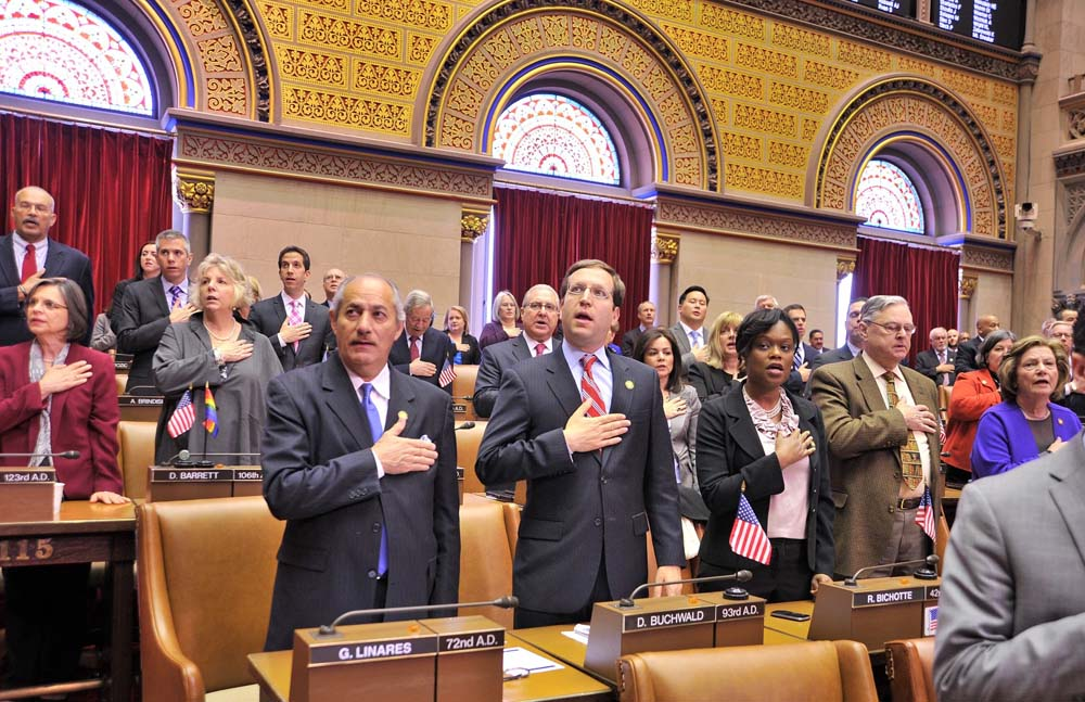 Assemblymember Bichotte joins fellow members in Chamber reciting the Pledge of Allegiance to open the first day of the 2015 session.