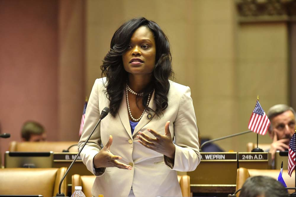 Assemblymember Bichotte speaks in favor of an increase in the minimum as the topic is debated in the Assembly Chamber.