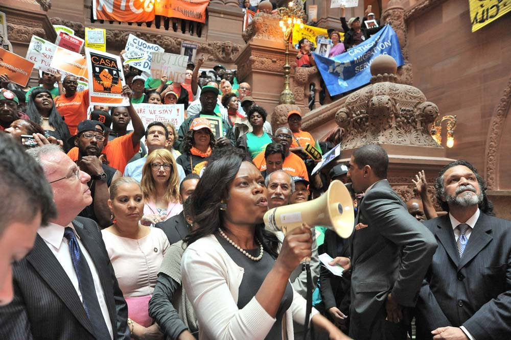 Assemblymember Bichotte uses a bullhorn to make sure her voice is heard to speak to activists, who were calling for stronger rent laws in New York City, at the State Capitol.