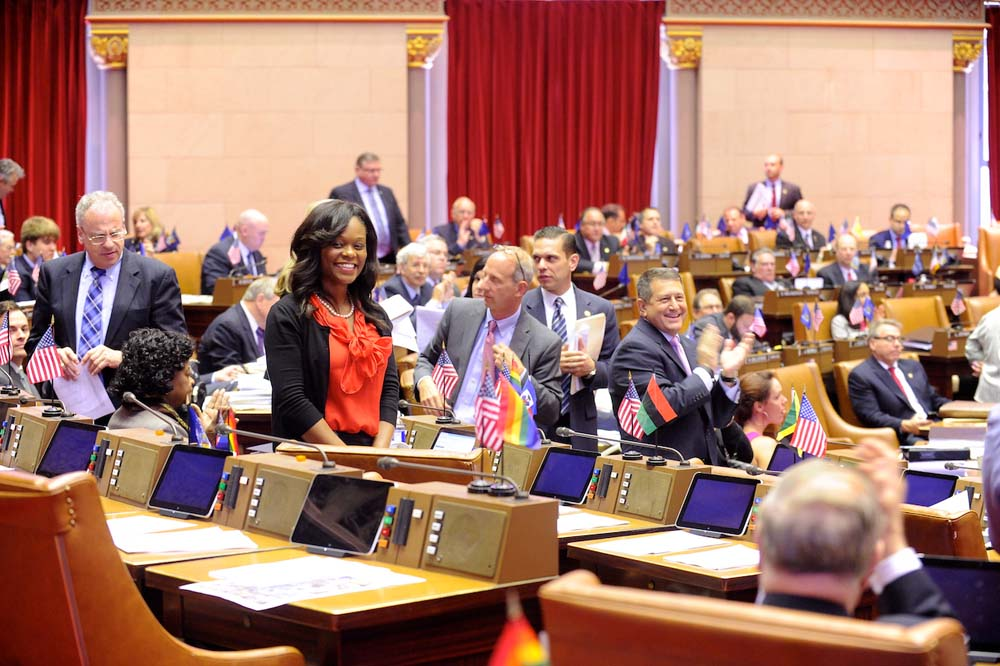 Assembly Majority Leader Joe Morelle leads applause in the Assembly Chamber after Assemblymember Bichotte had her first sponsored piece of legislation, A-7510, pass an assembly vote.