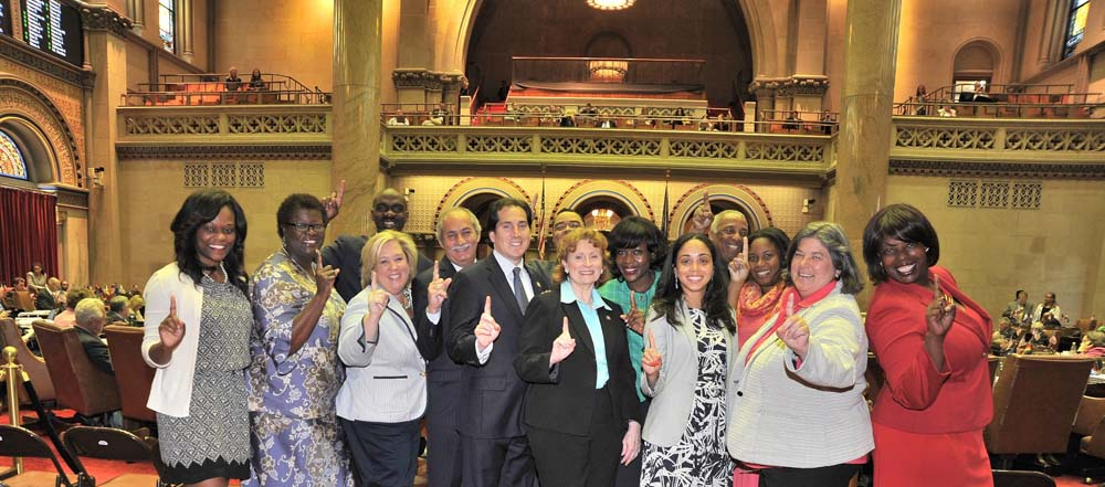 Assemblymember Bichotte, left, and the rest of the Class of 2015 assembly members celebrate after the close of their first session at the State Capitol.