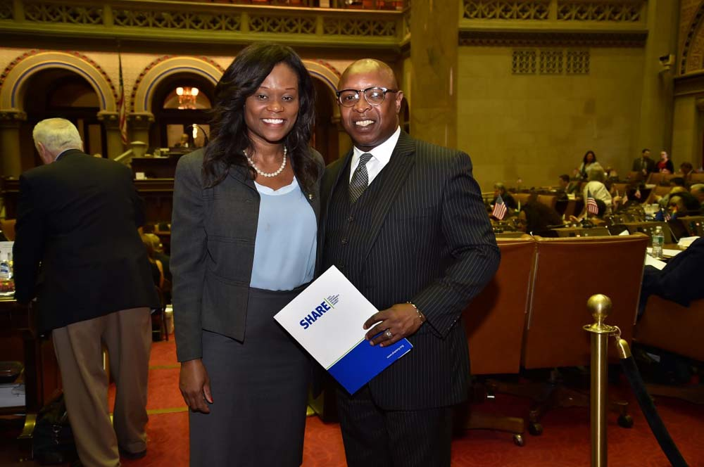 Assemblymember Bichotte welcomes guest Rev. Frank T. Farley, of Cornerstone Baptist Church in Bedford-Stuyvesant, to the Assembly Chamber.