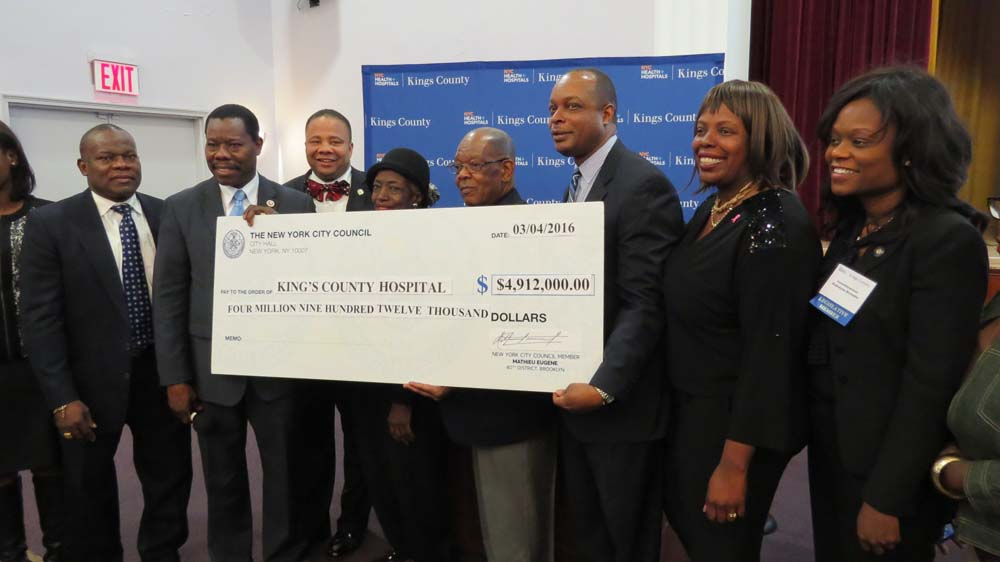 Assemblymember Bichotte, right, along with fellow Assemblymember Latrice Walker, Senator Jesse Hamilton, and Councilmember Matthieu Eugene at the Legislative Breakfast for Kings County Hospital, presenting them with a check for $4,912,000.00.