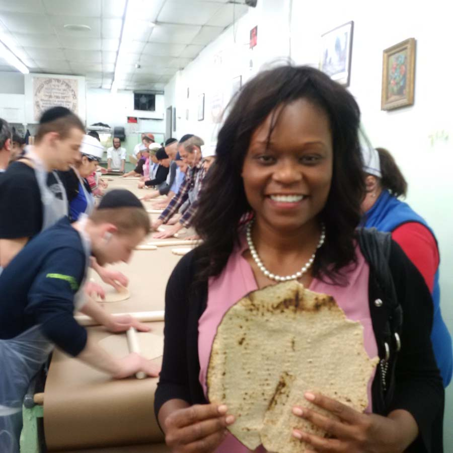 Assemblymember Bichotte at the Shmura Matzah Factory in Brooklyn. The making of the matzah requires a great deal of skill as one has to protect the ingredients from moisture and heat prior to mixing. The dough has to be prepared rapidly, and at a high temperature. Because fermented foods are forbidden during Passover, this whole process cannot exceed 18 minutes, which is the time frame in which fermentation is believed to occur.