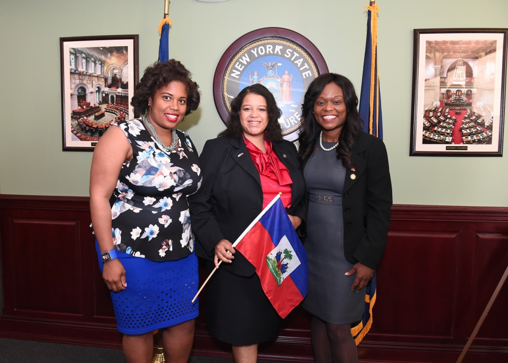 Assemblymember Rodneyse Bichotte (right) is joined by Assemblymembers Michaelle Solages and Kimberly Jean-Pierre in the Legislative Office Building as hosts and sponsors of Haitian Unity Day. Other hosts and sponsors included Assemblymembers Ellen Jaffee, and Diana Richardson, and Senators David Carlucci, and Kevin Parker.