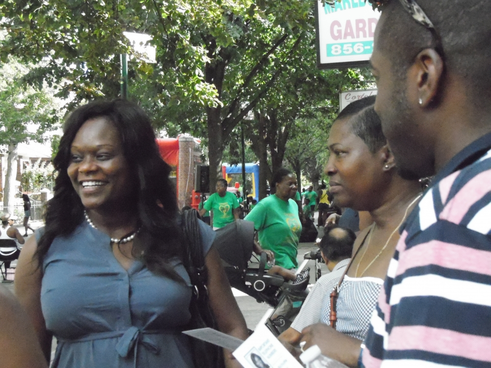 Assemblymember Bichotte speaks with parents during the block party hosted Cortelyou Road Early Childcare Center.<br />