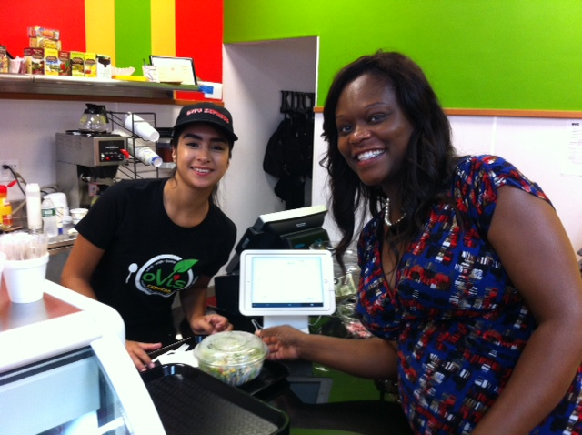Assemblymember Bichotte sampling the offerings at the grand opening of Ovi's Express.<br />