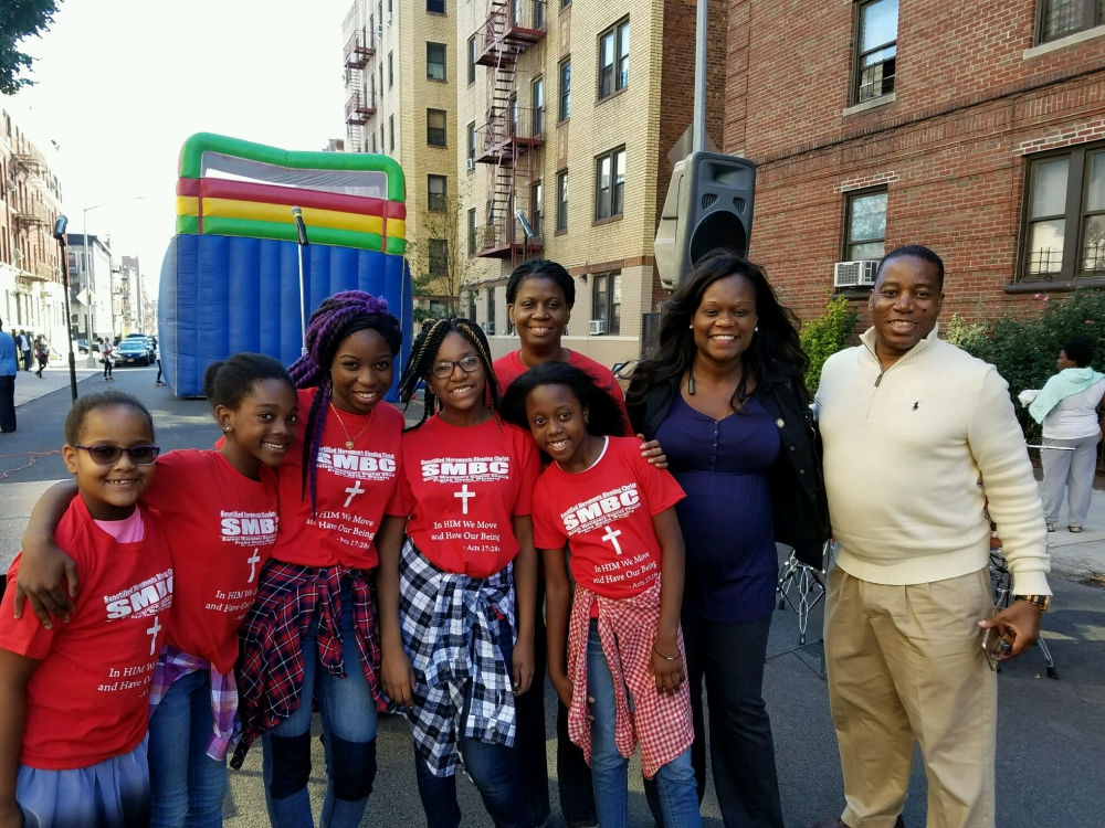 Assemblymember Bichotte with Pastor James Thornton of Salem Missionary Baptist Church and younger members of the church at their summer block party.<br />