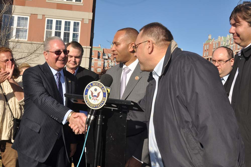 Assemblyman Steven Cymbrowitz greets a resident of the Oceana condominiums after a press conference on the Boardwalk with Rep. Hakeem Jeffries (center) calling on the Parks Department to abandon its p