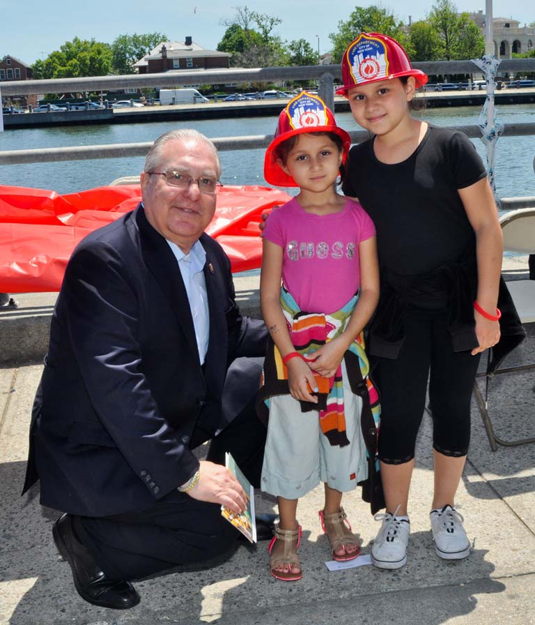 Two young ladies receive a lesson in fire prevention during Assemblyman Cymbrowitz� health fair.