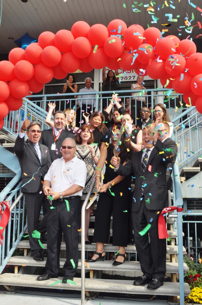 Assemblyman Cymbrowitz helps to welcome Macy�s Backstage to Sheepshead Bay during a ribbon-cutting ceremony on Emmons Avenue.