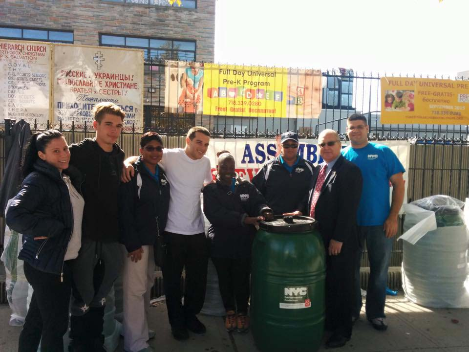During an event at Three Hierarchs Greek Orthodox Church, Assemblyman Cymbrowitz distributed more than 150 rain barrels to homeowners, in partnership with the New York City Department of Environmental