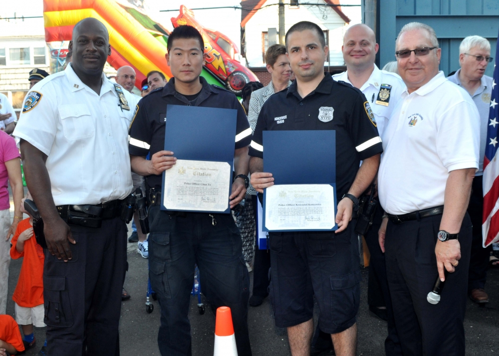 During this year's National Night Out Against Crime at the 61st Precinct, Assemblyman Cymbrowitz presented Assembly certificates to police officers Chun Yu (second from left) and Krzysztof Koncewicz (