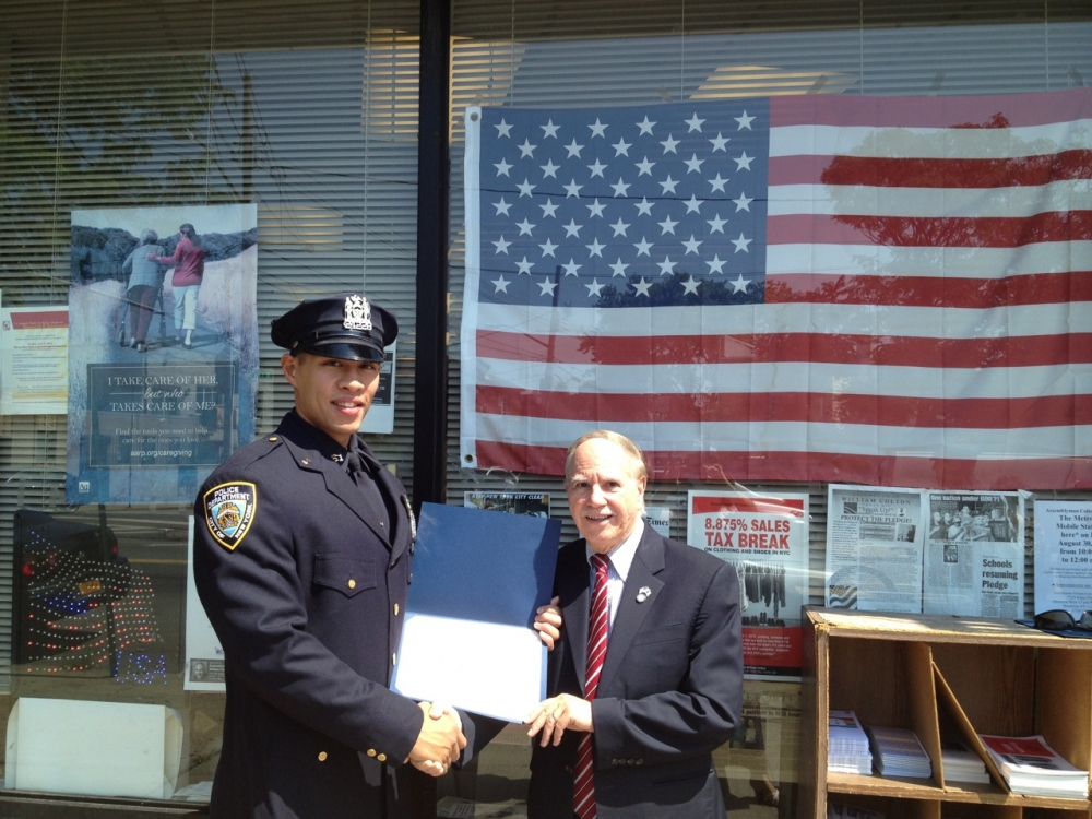Assemblymember Colton recognizing police officer for outstanding service to protect the neighborhood.<br /> <br />