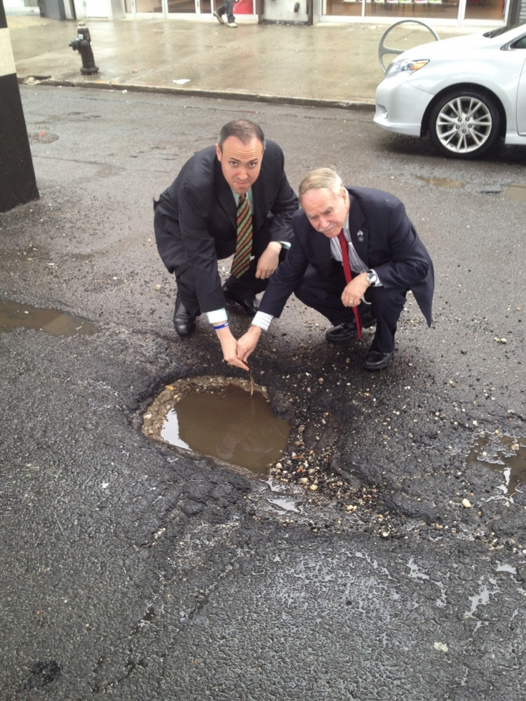 Assemblymember William Colton and Councilmember Mark Treyger documenting neighborhood pot holes to get the New York City Department of transportation to repave neighborhood streets.<br />