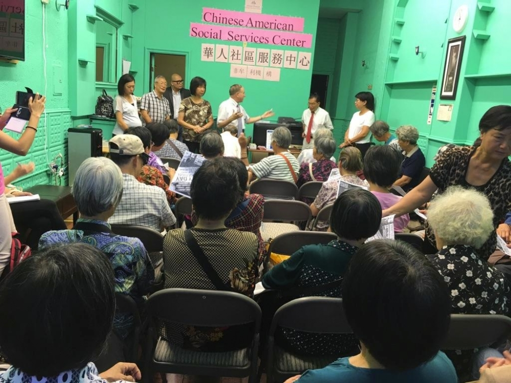 Assemblymember William Colton and Community Relations Director Nancy Tong making presentation at the Chinese American Social Service Center in the fall of 2016. <br />