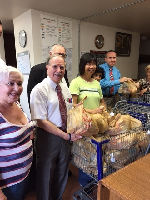 Assemblymember William Colton, Council Member Mark Treyger and Community Relations Director Nancy Tong helping with food giveaway at COJO of Bensonhurst.<br />
