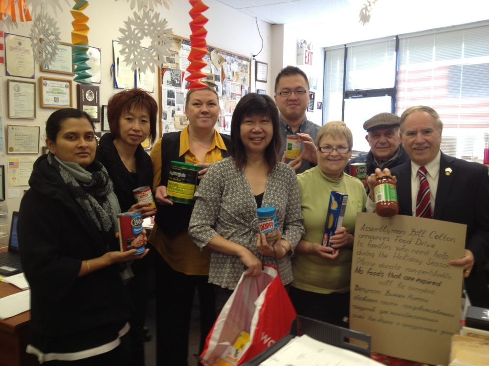 Assemblymember William Colton,  Coummunity Relations Director Nancy Tong and office staff members following one of numerous successful food drives organized by his office.<br />