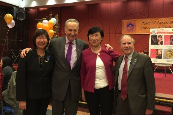 Assemblymember William Colton and Community Relations Director Nancy Tong with Senator Charles Schumer at Stuyvesant HS PA Dinner in 2016.<br />