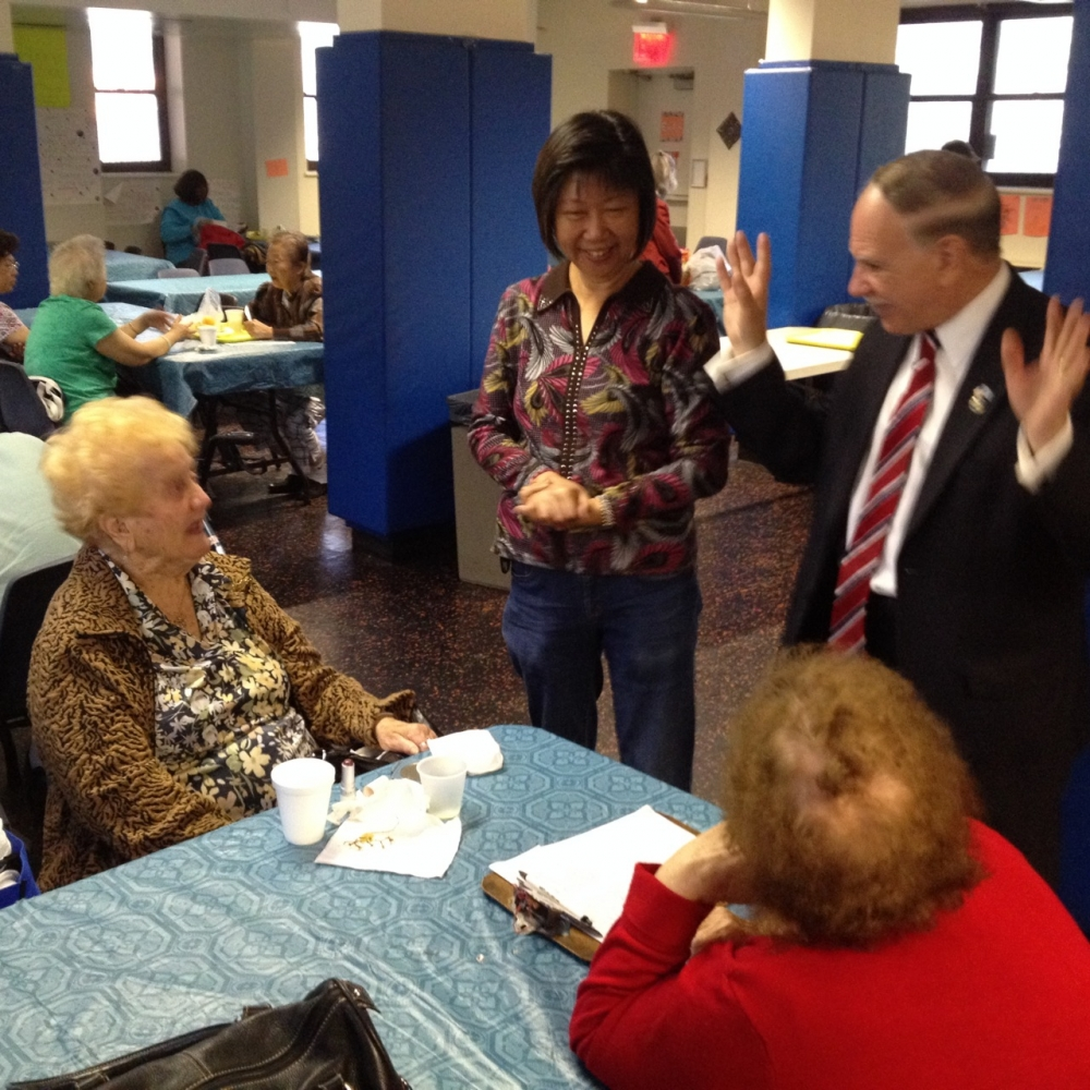 Assemblymember William Colton and community relations Director Nancy Tong with seniors at Marlboro Senior Center.<br /> <br />