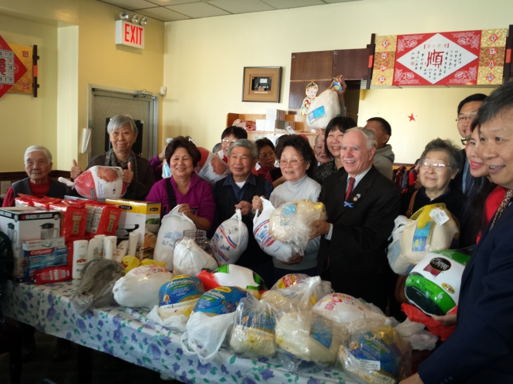 Assemblymember William Colton and Community Relations Director Nancy Tong with Homecrest Community Center Chair, Don Lee, at a turkey give away at the Homecrest Community Service Senior Center.  <br />