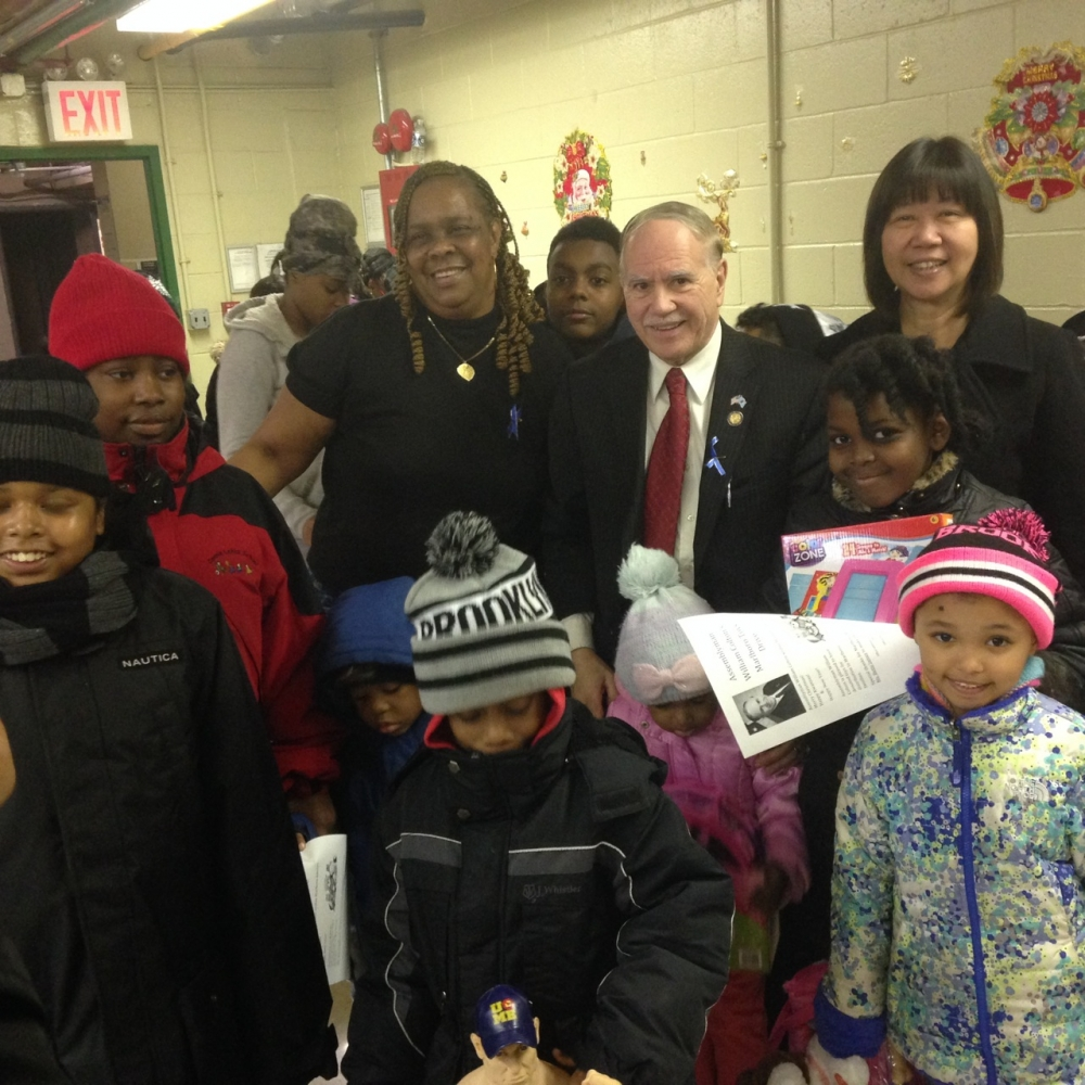 Assemblymember William Colton, Community Relations Director Nancy Tong with Marlboro Housing Residents Association President Betty James at a toy giveaway at Marlboro Housing.<br /> <br />