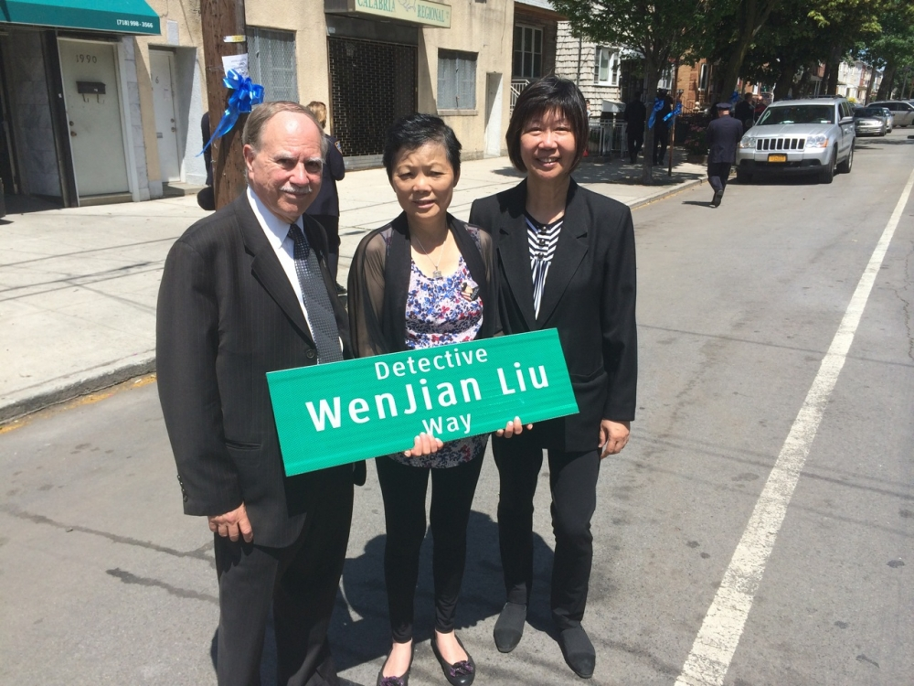 Assemblymember William Colton and Community Relations Director Nancy Tong with mother of Detective Wenjian Liu at renaming of street in honor of the slain police officer.<br /> <br />